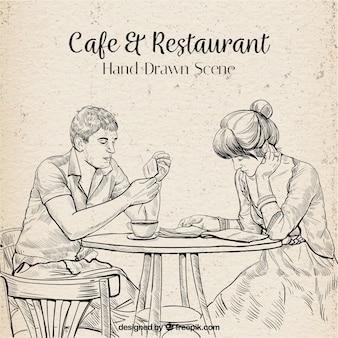Leitura desenhada por um casal em uma cafeteria