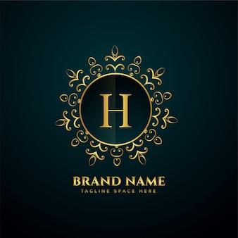 Letra de luxo h logotipo dourado oranmental