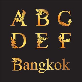 Letra elegante dourada a, b, c, d, e, f com elementos de arte tailandesa.