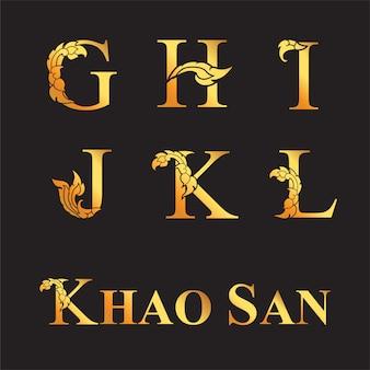 Letra elegante dourada g, h, i, j, k, l com elementos de arte tailandesa.
