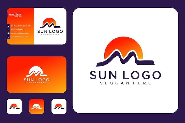 Letra m com design de logotipo do nascer do sol e cartão de visita