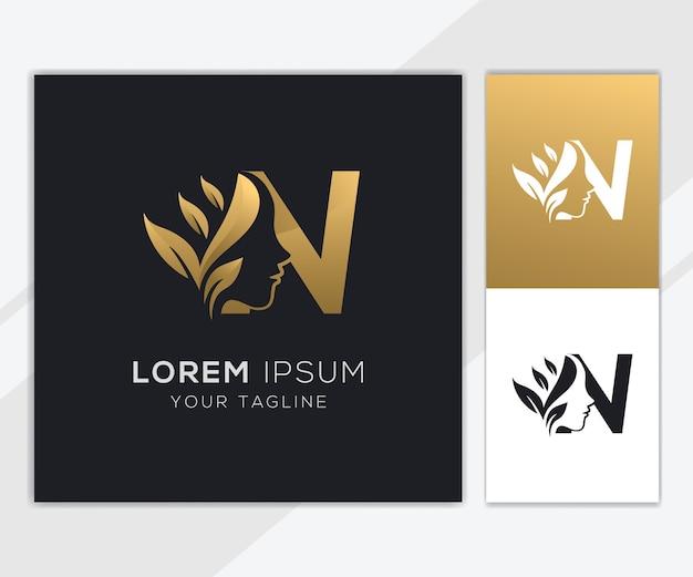 Letra n com modelo de logotipo de beleza feminina natural de luxo