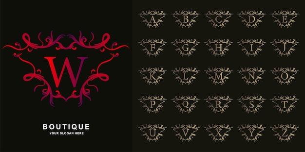Letra w ou alfabeto inicial de coleção com modelo de logotipo dourado moldura floral ornamento de luxo.