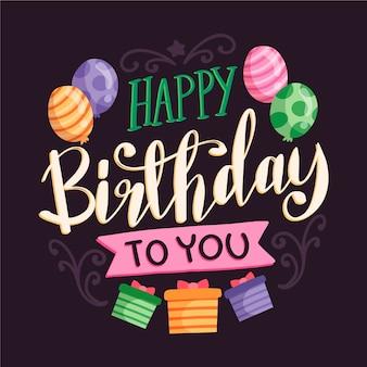 Letras de aniversário com balões e presentes