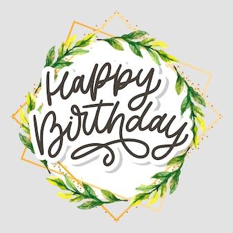Letras de caligrafia de feliz aniversário com guirlanda floral
