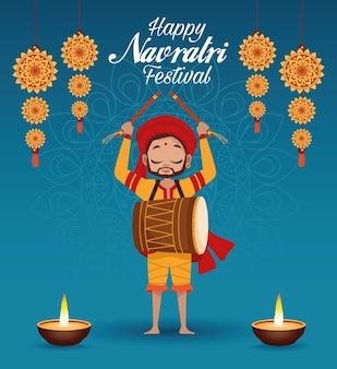 Letras de cartão de celebração feliz navratri com homem tocando tambor e velas