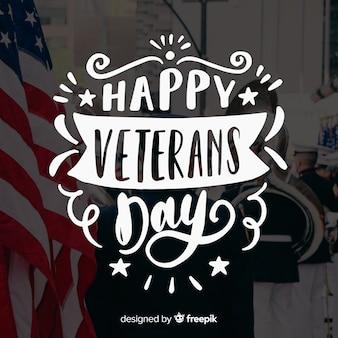 Letras de dia dos veteranos com estrelas e fitas