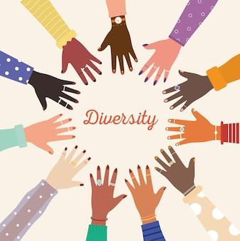 Letras de diversidade e diversidade de mãos unidas no centro