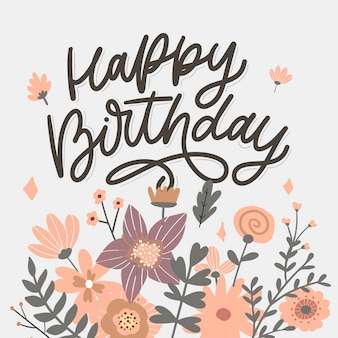 Letras de feliz aniversário, slogan de caligrafia com flores