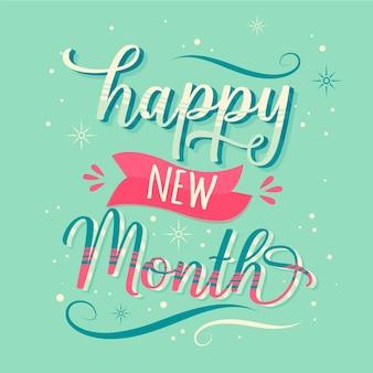 Letras de 'feliz mês novo' com detalhes desenhados à mão