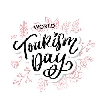 Letras de mão do dia do turismo mundial em fundo branco.