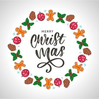 Letras de mão na moda com quadro colorido de férias de natal com atributos tradicionais no estilo de linha.