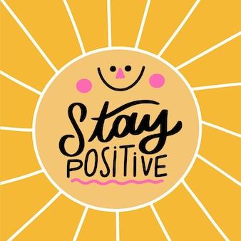 Letras de mente positiva com sol sorridente