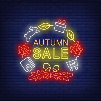Letras de néon de venda outono com carteira, coelho, folhas de outono