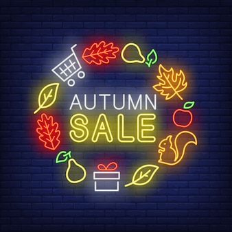 Letras de néon de venda outono com folhas, peras, presente, esquilo