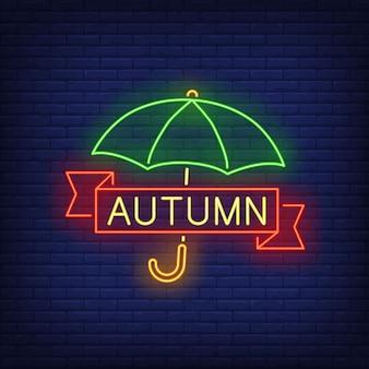 Letras de néon outono com guarda-chuva
