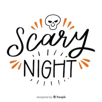 Letras de noite assustadora com caveira