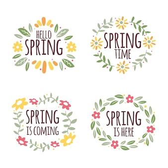Letras de primavera rodeadas por emblemas de quadro floral