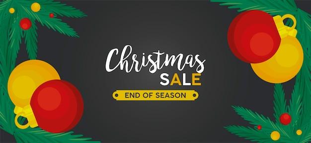 Letras de venda de feliz natal com bolas e folhas em uma ilustração de moldura preta