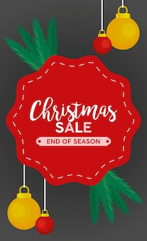 Letras de venda de feliz natal com bolas penduradas no quadro.