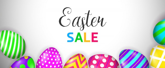 Letras de venda de páscoa e ovos pintados brilhantes