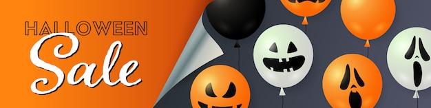 Letras de venda do dia das bruxas com balões de abóbora e fantasma
