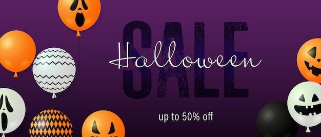 Letras de venda do dia das bruxas com balões fantasma