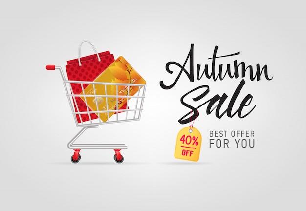 Letras de venda outono com bolsa e cartão de crédito no carrinho de compras