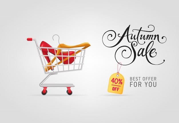 Letras de venda outono com cabide e sapato no carrinho de compras