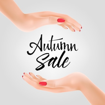 Letras de venda outono entre as duas mãos