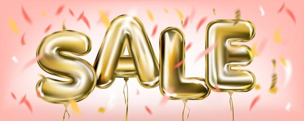 Letras de venda por balões de folha de ouro no ar