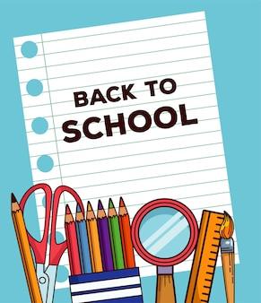 Letras de volta às aulas em folha de caderno com suprimentos