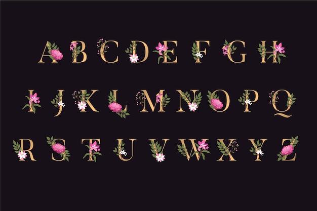 Letras do alfabeto dourado com flores elegantes