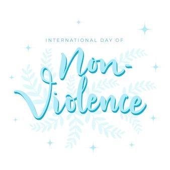 Letras do dia internacional da não-violência com folhas e brilhos