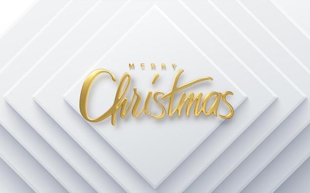 Letras douradas de feriado de feliz natal em fundo de papel branco