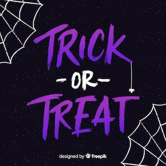Letras roxas de doces ou travessuras com teia de aranha