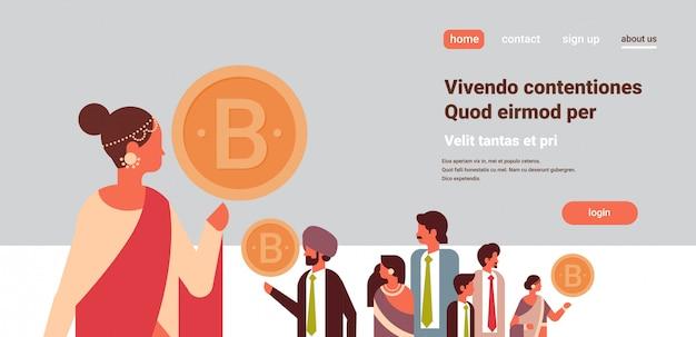 Líder de empresária indiana segurando a bandeira de criptomoeda bitcoin