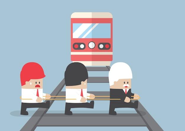 Líder empresarial cruzando a ferrovia ignorando sua equipe.