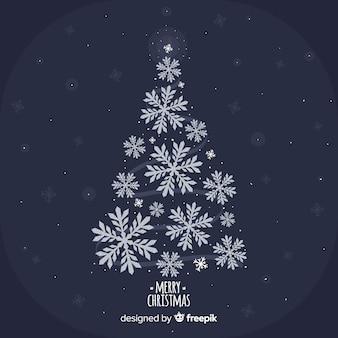 Linda árvore de natal com flocos de neve