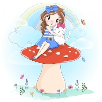 Linda garota abraçando gatinho sentado no cogumelo