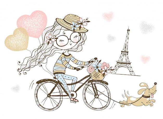 Linda garota anda de bicicleta com seu cachorro em paris.