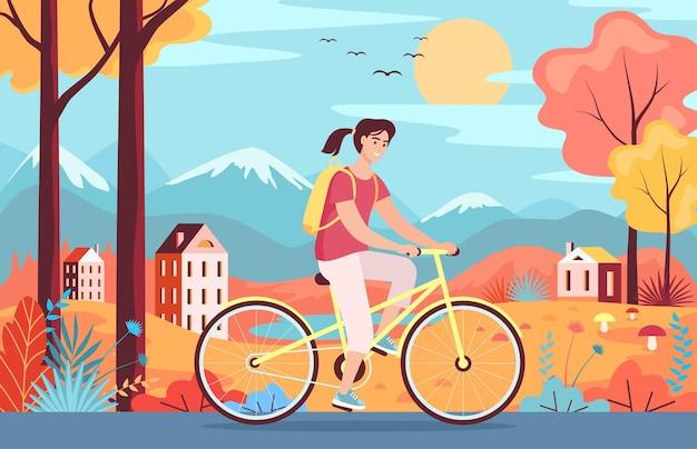 Linda garota andando de bicicleta amarela no parque paisagem colorida de outono