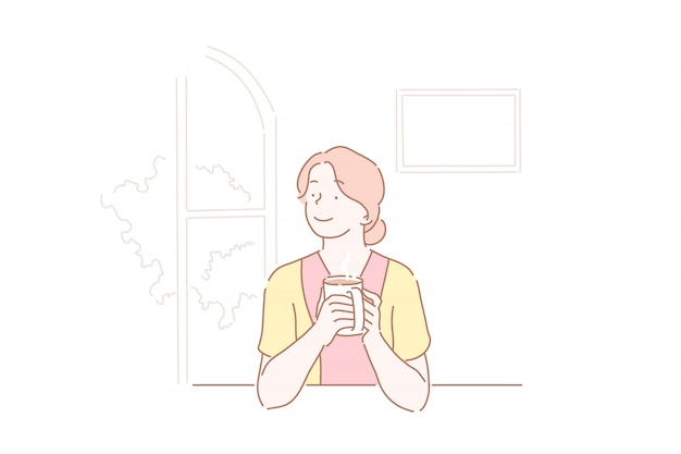 Linda garota, bebendo uma xícara de café na cozinha.