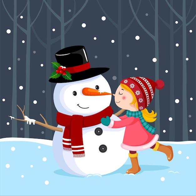 Linda garota beijando um boneco de neve