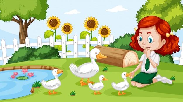 Linda garota brincando com pato