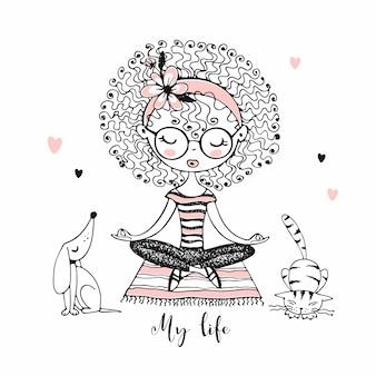 Linda garota com cachos sentado na posição de lótus, ao lado de animais de estimação fofos. estilo de vida.