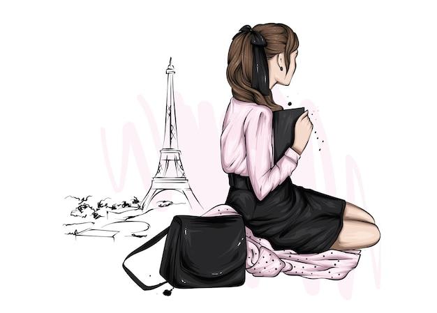 Linda garota com roupas elegantes e a torre eiffel