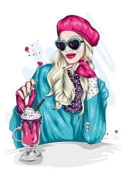 Linda garota com roupas elegantes e sobremesa