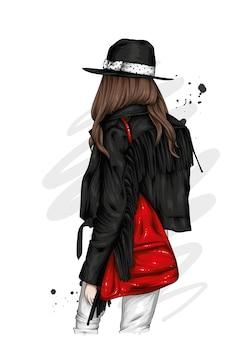 Linda garota com uma jaqueta elegante e um chapéu