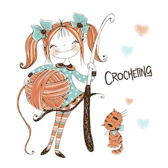Linda garota costureira com uma agulha de crochê nas mãos.
